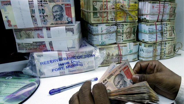 Bank employee counts rupee notes