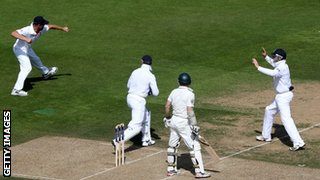 Jonathan Trott (left) celebrates taking the catch to dismiss Chris Rogers