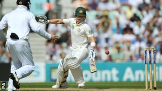 Michael Clarke scrambles back as the ball just misses the stumps