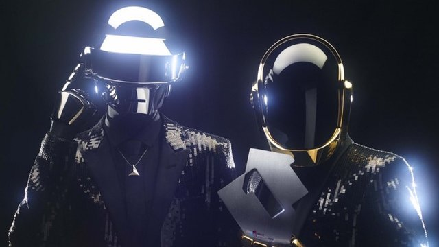 Daft Punk in May 2013, celebrate topping the UK album chart for the first time in their 20 year career