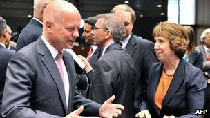UK's William Hague with fellow EU ministers in Brussels, 21 Aug 13