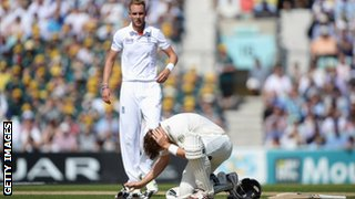 Shane Watson on the floor after being hit on the head by Stuart Broad