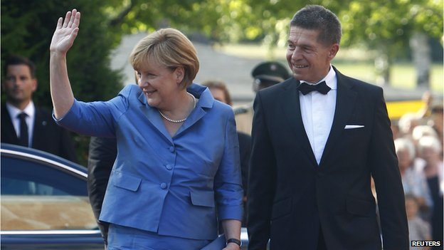German Chancellor Angela Merkel and her husband Joachim Sauer arrive on the red carpet for the opening of the annual Bayreuth Wagner opera festival at the Gruener Huegel (Green Hill) in Bayreuth, July 25, 2013