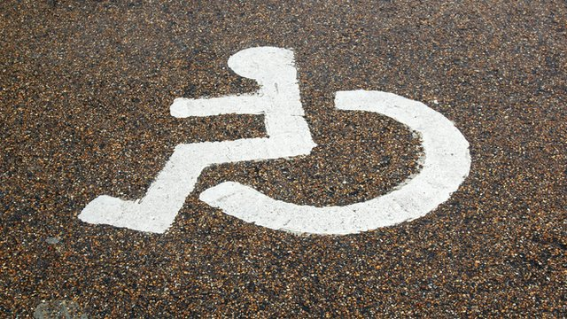 A parking bay with wheelchair logo