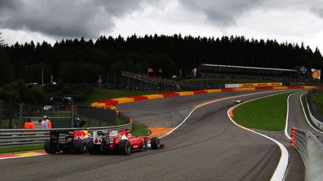 Mark Webber and Fernando Alonso drive through Eau Rouge