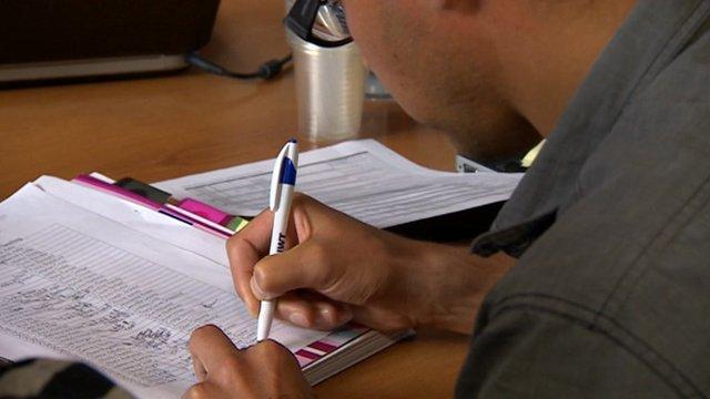 A boy doing exams