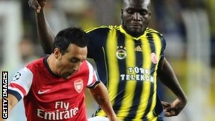"Arsenal's Santi Cazorla (left) and Fenerbahce""s Moussa Sow"