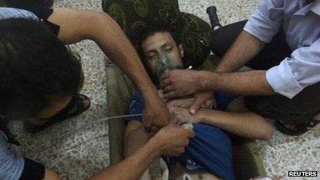 A man, affected by what activists say is nerve gas, breathes through an oxygen mask in the Damascus suburbs of Jesreen August 21, 2013