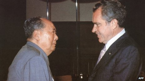 Chinese communist leader Chairman Mao Zedong (L) welcomes US President Richard Nixon to his house in the Beijing Forbidden City on 22 February 1972