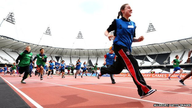 children running in Olympic stadium