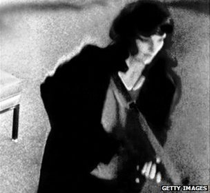 A CCTV image showing Patty Hearst armed during a bank robbery