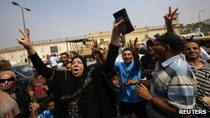 A supporter of former president Hosni Mubarak celebrates as she waits for his release in front of the main gate of Tora prison on the outskirts of Cairo, 22 August 2013