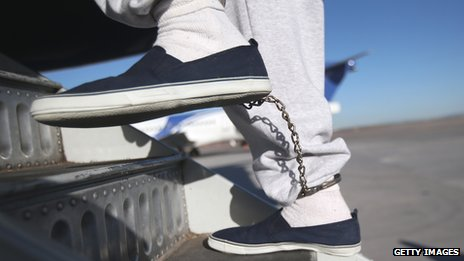 A deportee boards a flight in Arizona