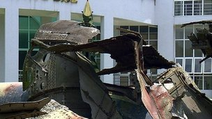 Plane wreckage outside a building in Hanoi