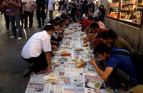 A group hold an Iftar meal during Ramadan in a street in Istanbul