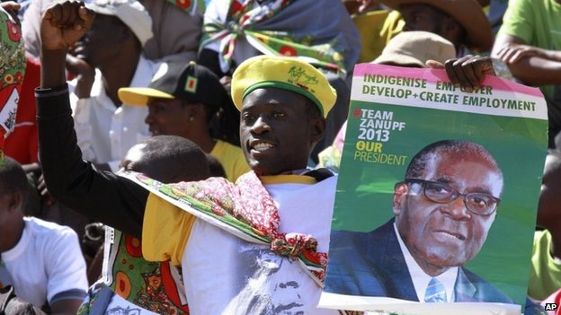 A supporter of Zimbabwean President Robert Mugabe attends his inauguration in Harare, Thursday, 22 August 2013