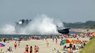 A hovercraft lands on a beach in Russia
