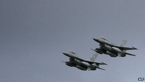 American, US-built F-16 jets fly over the Krzesiny air base in Poznan during a ceremony 09 November 2006
