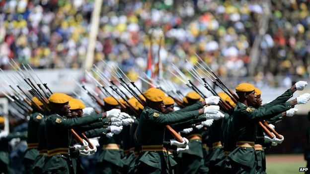 Zimbabwean's Guard of Honor march during veteran leader Robert Mugabe swearing-in ceremony in Harare on 22 August 2013