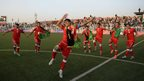 Afghan footballers celebrate their 3-0 win against Pakistan