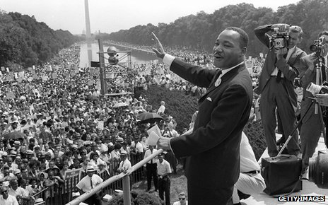 Martin Luther King waves to supporters from the steps of the Lincoln Memorial 28 August, 1963