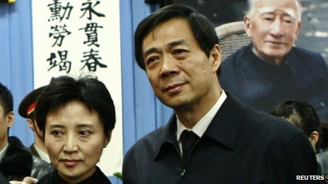 "China""s former Chongqing Municipality Communist Party Secretary Bo Xilai (R) and his wife Gu Kailai pose for group photos at a mourning held for his father Bo Ibo, former vice-chairman of the Central Advisory Commission of the Communist Party of China, in Beijing in this January 17, 2007 file photo"