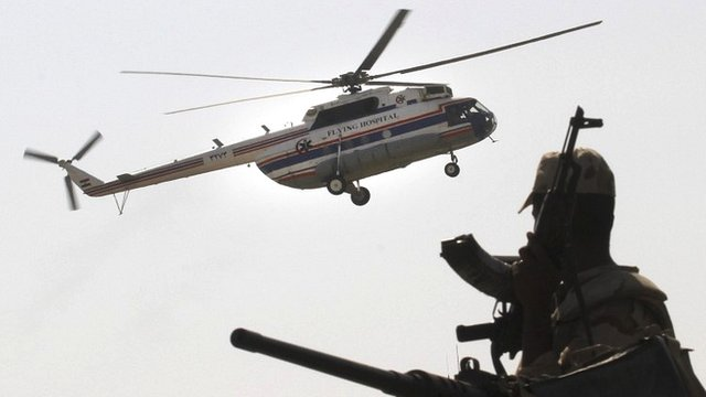 An Egyptian soldier stands guard as a helicopter carrying former Egyptian President Hosni Mubara, lands at Maadi Military Hospital