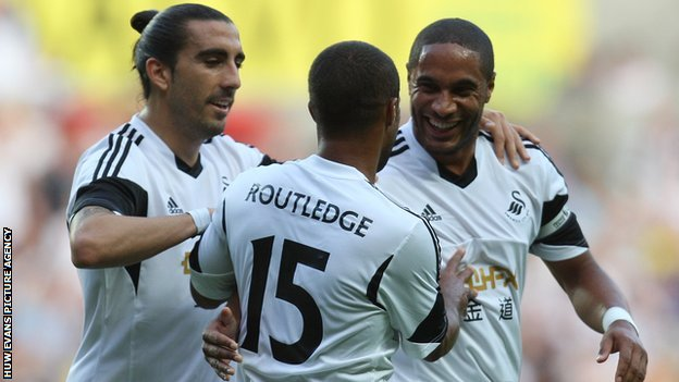 Wayne Routledge gets the Swansea congratulations