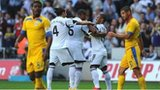 Swansea player Wayne Routledge (r) celebrates with team mates
