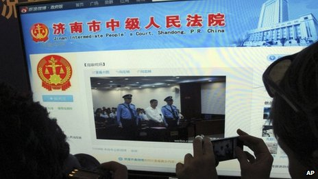 A journalist takes photos of a microblog by Jinan Intermediate People's Court on 22 August 2013