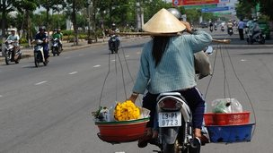 Woman on motorbike in Da Nang