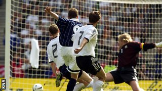 Kenny Miller scores against Germany