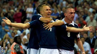 Kenny Miller is congratulated after scoring against England at Wembley