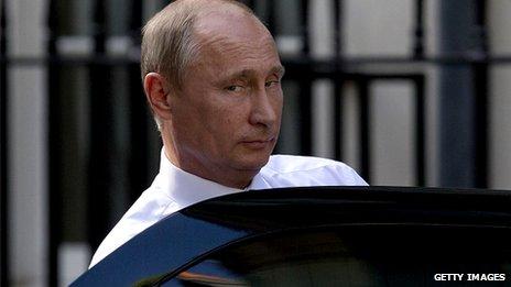 Vladimir Putin getting into a car