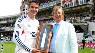 Kevin Pietersen is presented with a silver bat by ECB chairman Giles Clarke for becoming England's leading scorer in international cricket