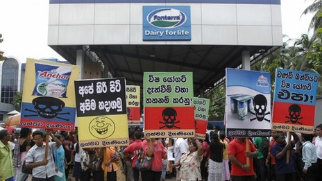 Sri Lankan demonstrators shout slogans during a protest against Fonterra products in front of the main factory in Biyagama, about 21 km (14 miles) from capital Colombo, August 22, 2013.