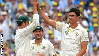 Mitchell Starc celebrates the wicket of Jonathan Trott