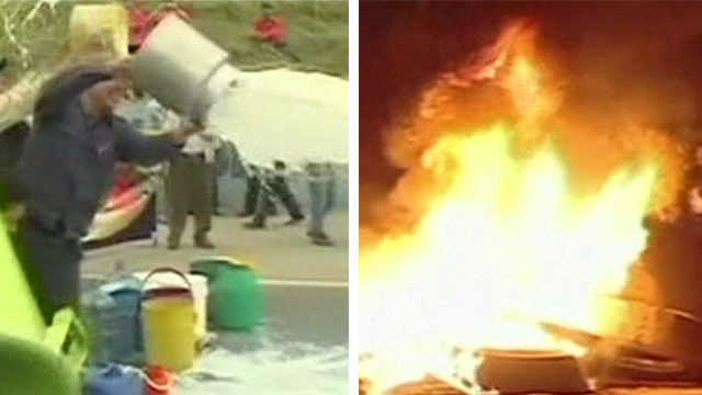 Farmers throw milk while tyres burn amid Colombia protests