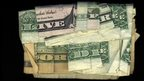 """Live free or die"" written using dollar bills"