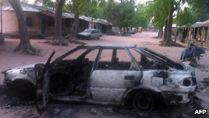 A burnt vehicle after a suspected Boko Haram attack in Bama, Nigeria. Photo: May 2013