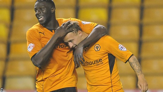 Leigh Griffiths (right) is embraced by Bakary Sako