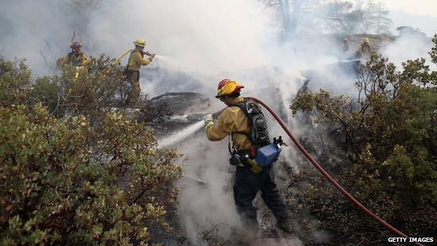 Firefighters tackle the Rim Fire in  in Yosemite National Park, California, on 23 August 2013