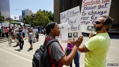 A supporter of San Diego Mayor Bob Filner (left), states her point of view to a man who wanted him to quit, during a pro-Filner rally in San Diego, California, on 19 August 2013