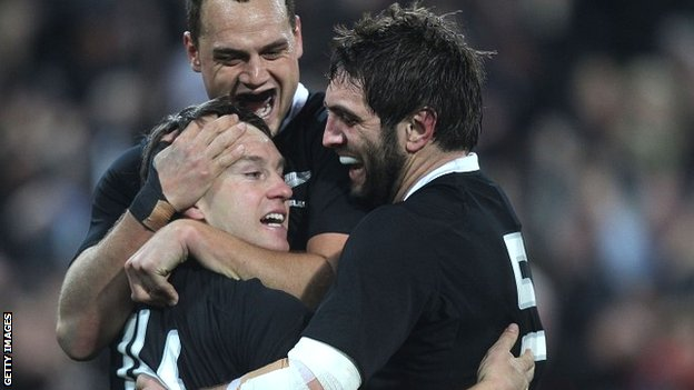 Israel Dagg (top) and Sam Whitelock (right) congratulate New Zealand try-scorer Ben Smith