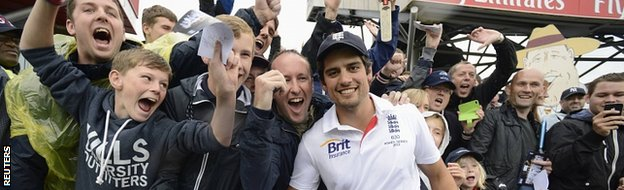 England captain Alastair Cook poses with fans