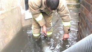 Firefighter tackling floods