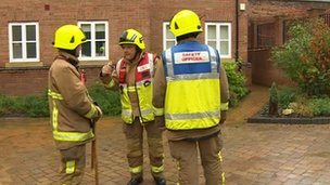 Firemen outside evacuated flats in Billericay