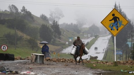 A man carries milk on a horse in Ventaquemada, Boyaca on 23 August 2013