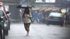 A woman with umbrella in Notting Hill