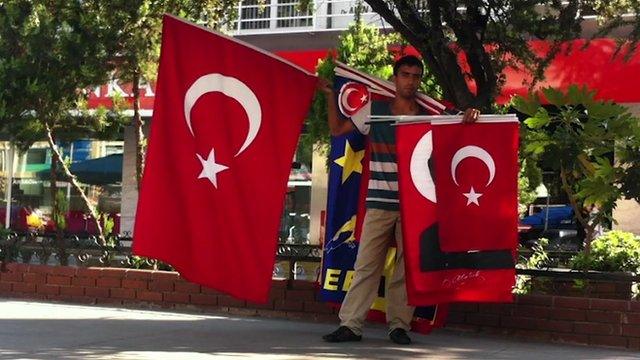 Man holds flags